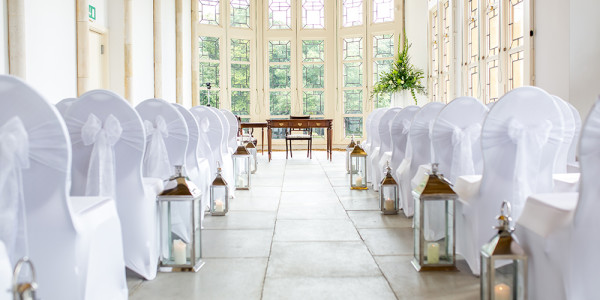 WHITE CHAIRS CEREMONY ROOM